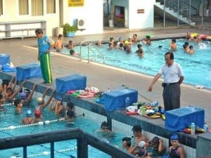 Those Old Men are coaches for more advance levels. They are giving instruction to the swimmers.